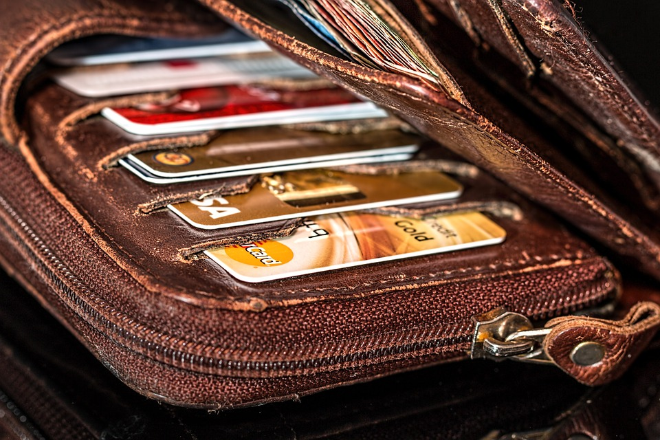 CREDIT CARDS in a brown wallet