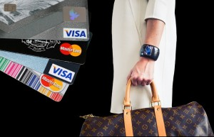 Woman with a Louis Vuitton bag and credit cards.