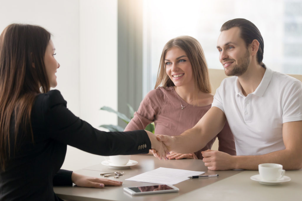 Couple getting a personal loan with a loan officer
