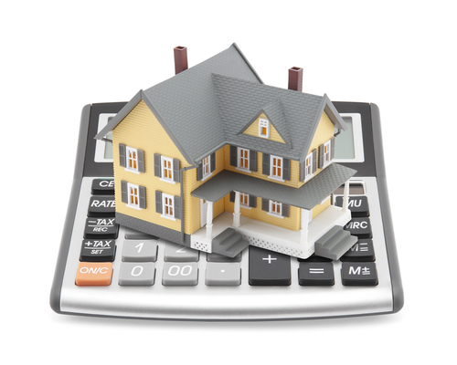 House on top of a mortgage calculator