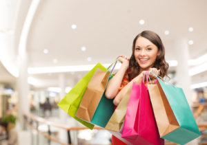 Woman shopping with colorful bags and earning extra income with