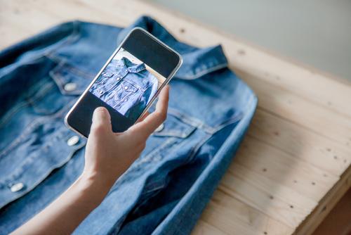 Woman selling her denim shirt online