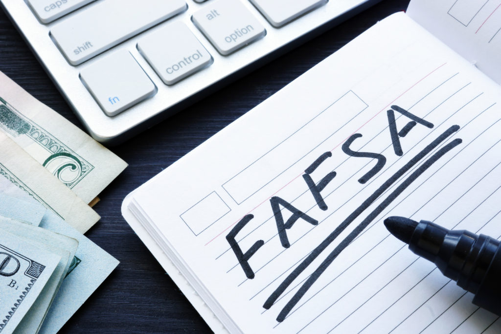 FAFSA in a notebook to apply for Student Loans