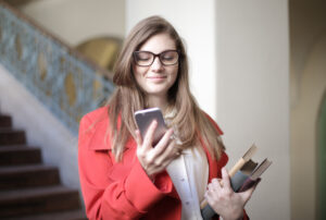 Female student looking at student loan options on a cellphone